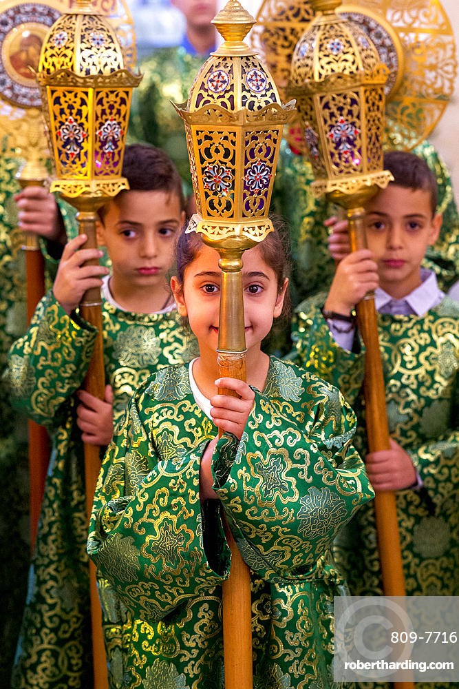 Altar boys and girls at Celebration of the Myrrh bearers' Sunday in the Nazareth Melkite (Greek Catholic) church, Galilee, Israel, Middle East