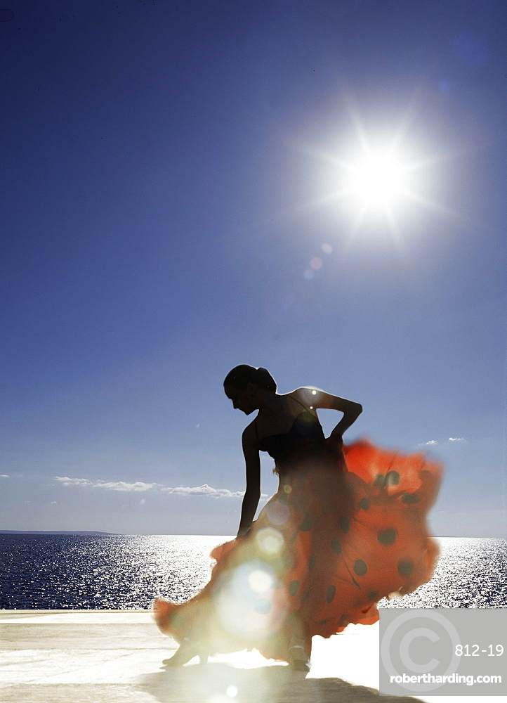 Flamenco dancing by sea in full sunlight, Ibiza, Spain, Europe