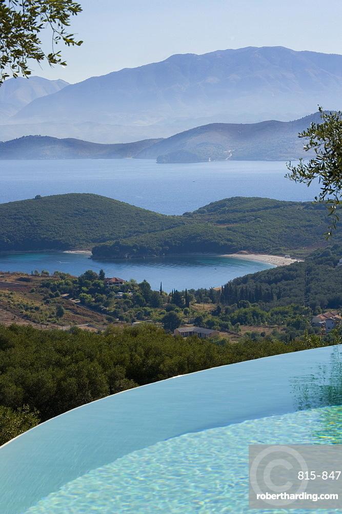 Vew across infinity pool to the Ionian Sea and Albanian Mountains, Kerkyra, Corfu, Ionian Islands, Greek Islands, Greece, Europe