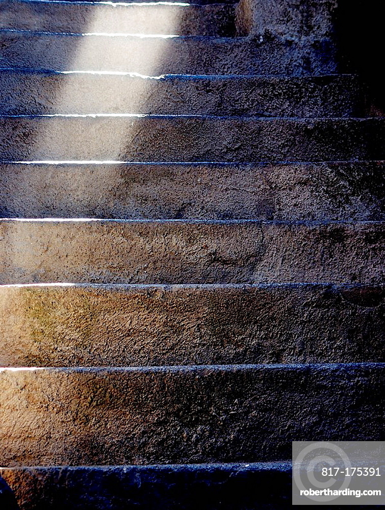 Old stone stairs in Vernazza, in the Liguria region, with a spot lateral light