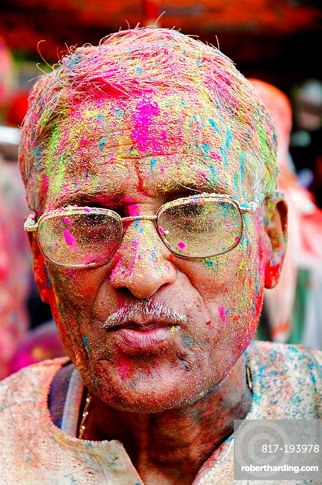 Panjim Goa, India, man with colored powder on the face during the Holi feast