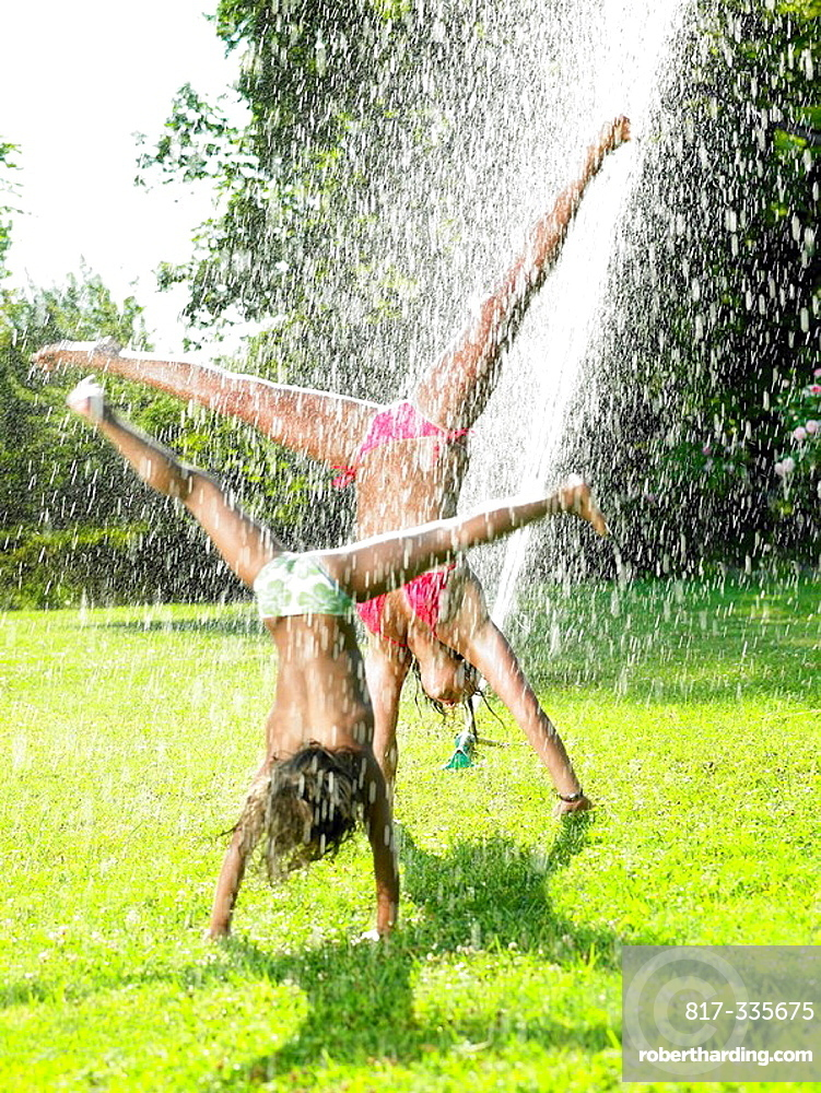 Girls playing under a water jet, Girls playing under a water jet