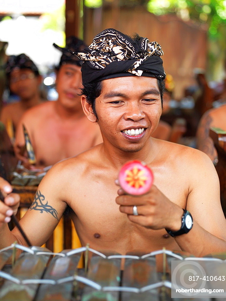 Indonesian men and boys playing traditional instruments