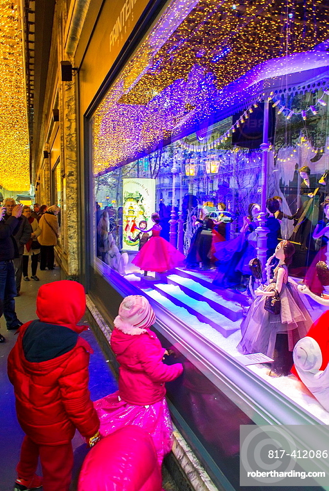 Paris, France, Children Window Shopping, at French Department Store Printemps, Dior Shop with Christmas Decorations, Window Display at Night