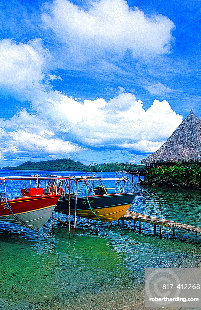 Beautiful scene of boats and blue & green water and clear blue colors of the islands of in Tahiti in French Polynesia
