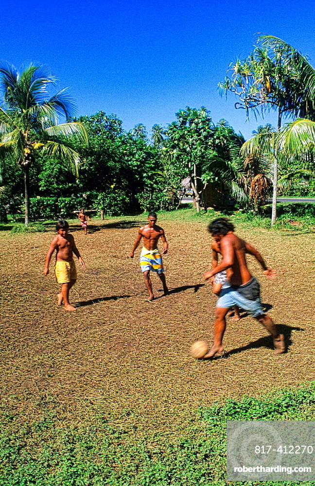 Children playing soccer in Heapiti in Tahiti in French Polynesia