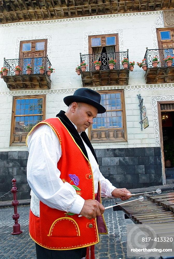 Xylophone Player In Front Of The Casa De Los Balcones, La Orotava, Tenerife, Canary Islands, Atlantic Ocean
