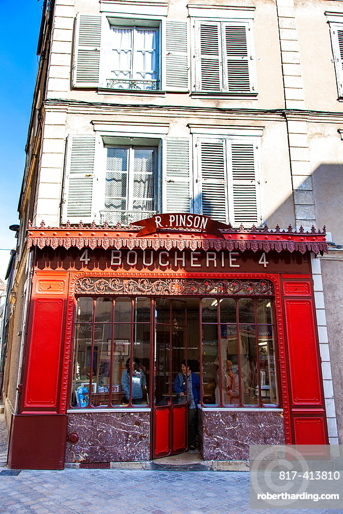 Red old boucherie shop facade in Chartres, Loire, France