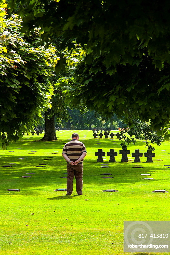 Graves and visitors at the German war cemetery at La Cambe, Normandy, France