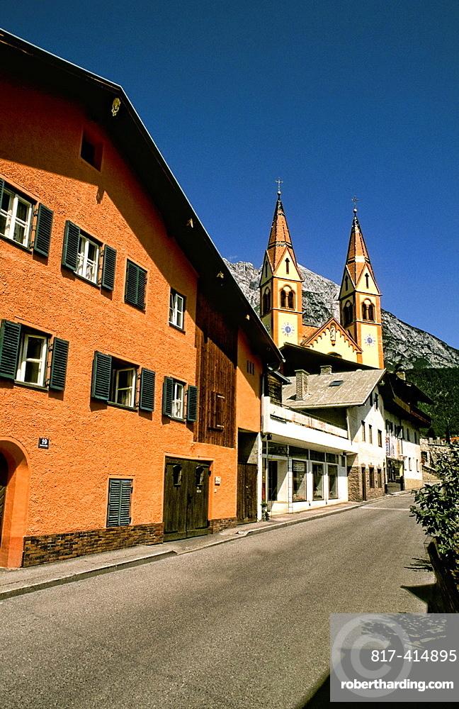 Street leading to Peter and Paul Catholic Church color in Telfs Austria near Innsbruck