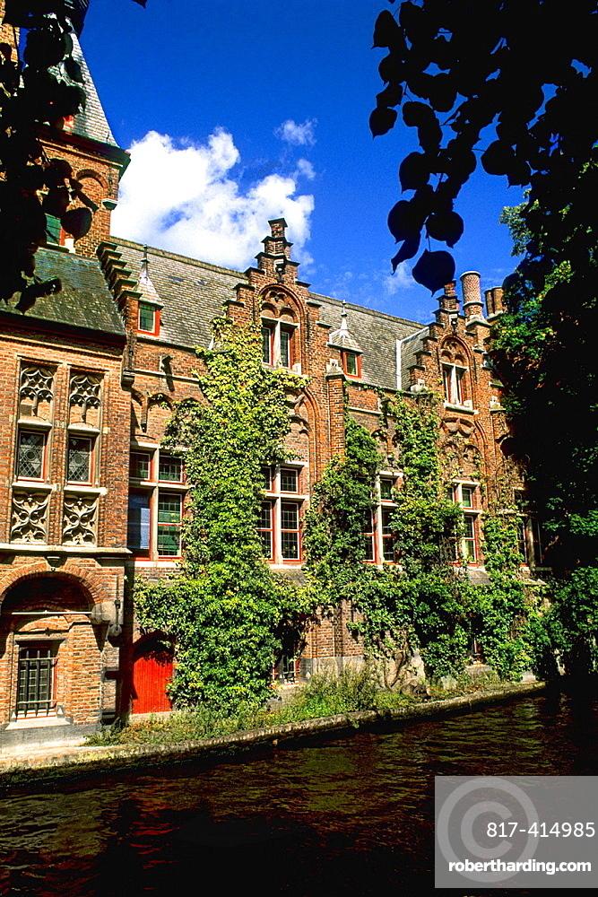 Belgium Ivy covered buiildings on Canals of beautiful Bruges Belgium