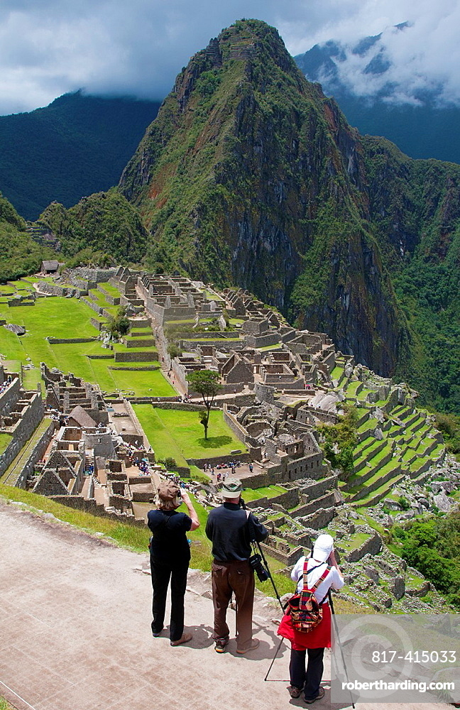 Machu Picchu famous ruins from above with photographers and tripods shooting photos in Peru from Inca history