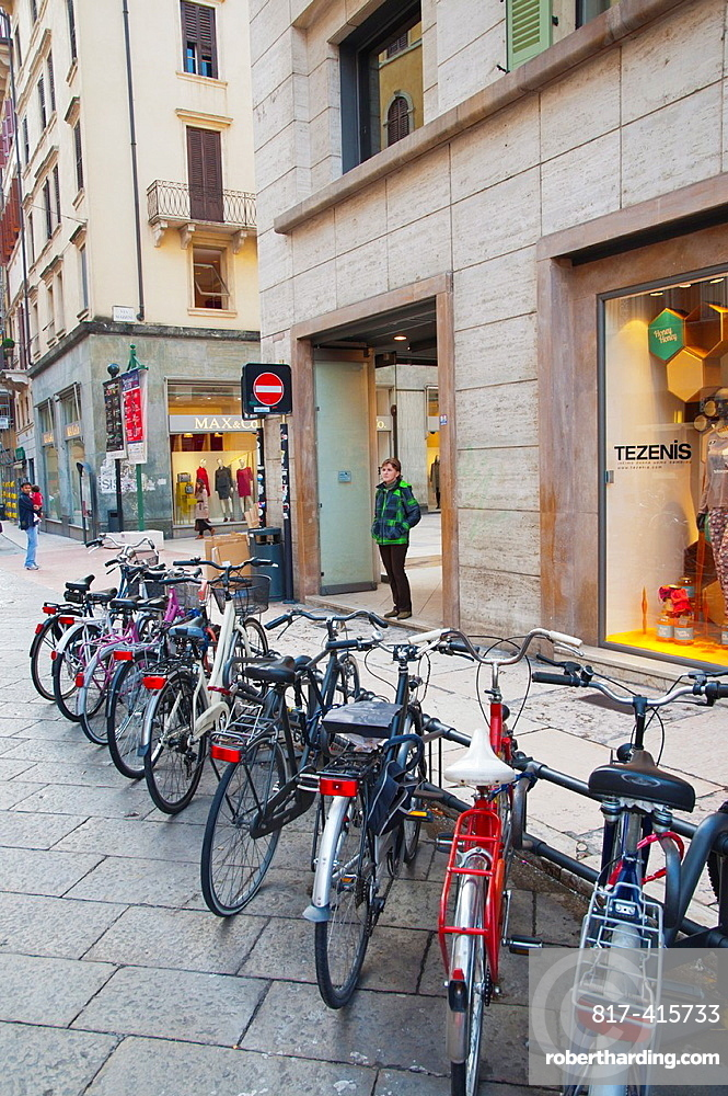 Parked bicycles along via Mazzini pedestrian street old town Verona city the Veneto region northern Italy Europe