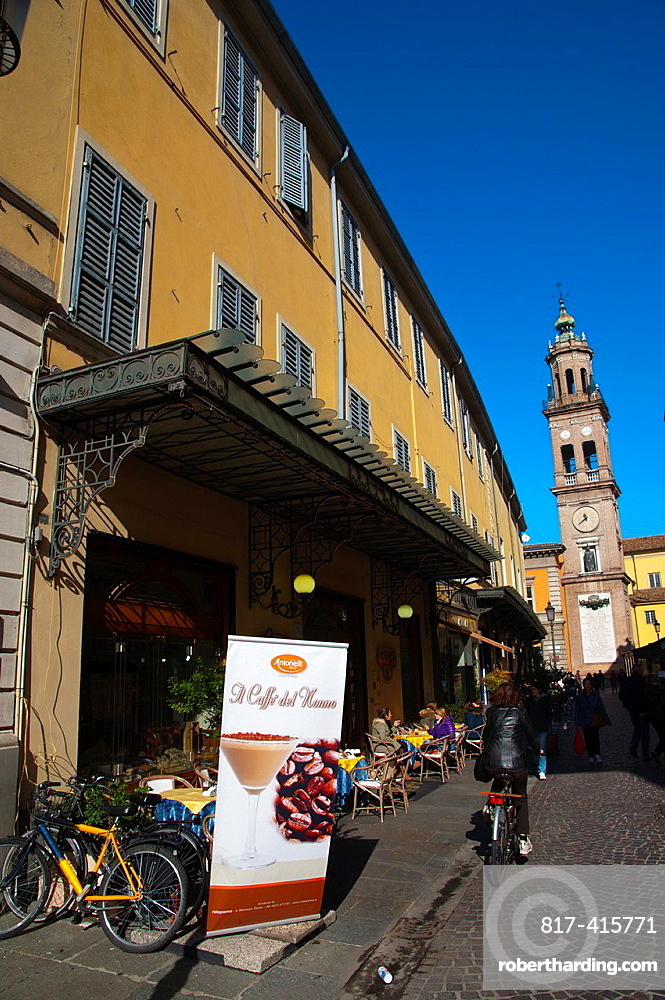 Street cafe with the San Giovanni Evangelista church bell tower in background central Parma city Emilia-Romagna region central Italy Europe