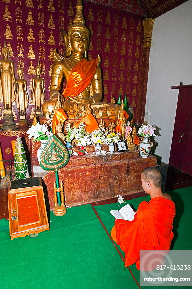 Young monk in temple or wat Luang Prabang Laos