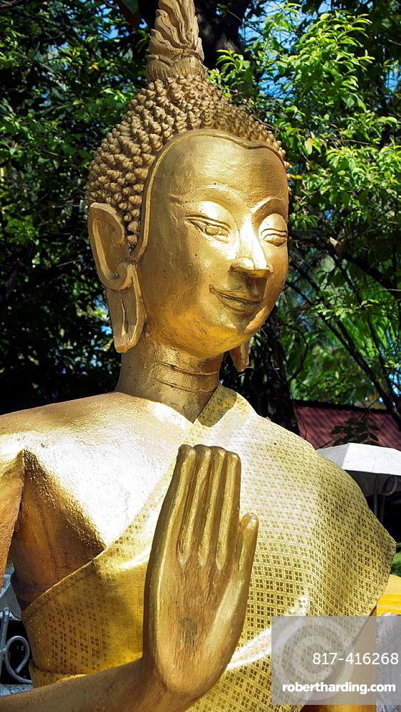 Golden Buddha statue Wat Si Muang Vientiane Laos PDR
