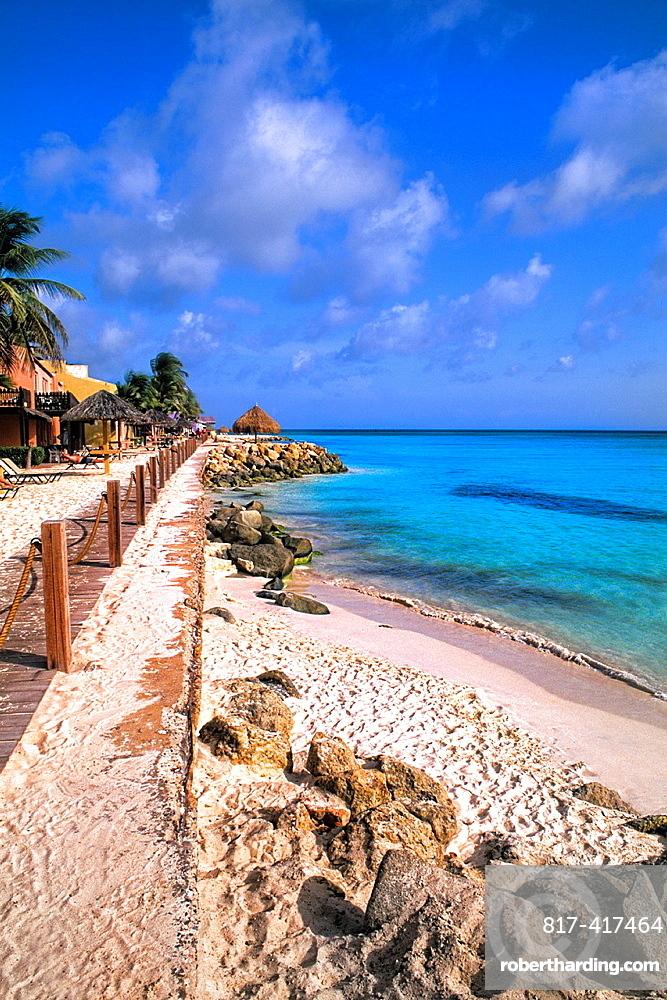 Beach and Rocks of colorful Divi Tamaarian Resort in Aruba