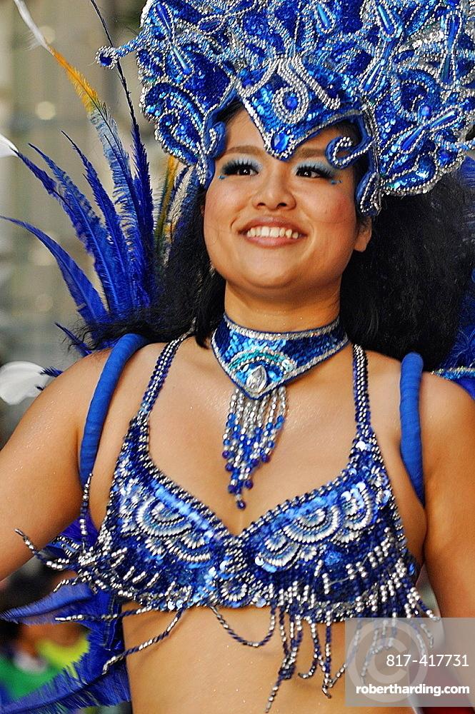 Naha, Okinawa, Japan, Brazilian-style, Japanese samba dancer along Kokusai-dori during the Naha Festival October
