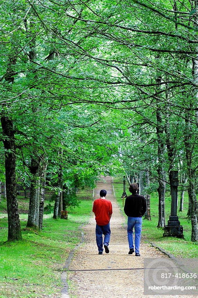 Forest landscape with beechsand visitors at Urkiola Natural Park, Vizcaya, Basque Country, Spain