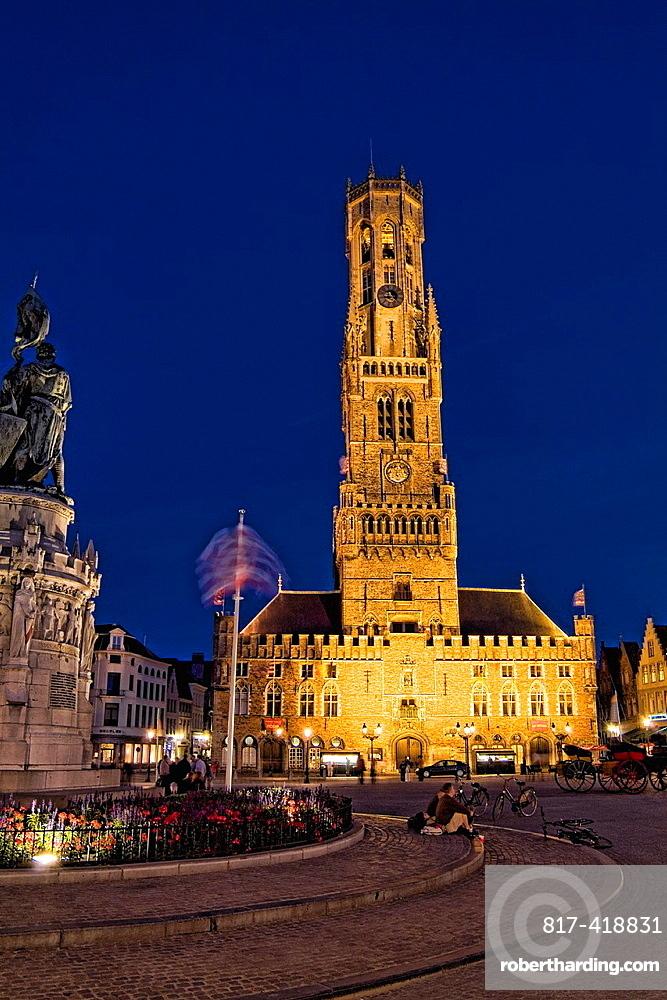 Belgium night photo of Famous Belfort Church in Marketplace in downtown Bruges Belgium
