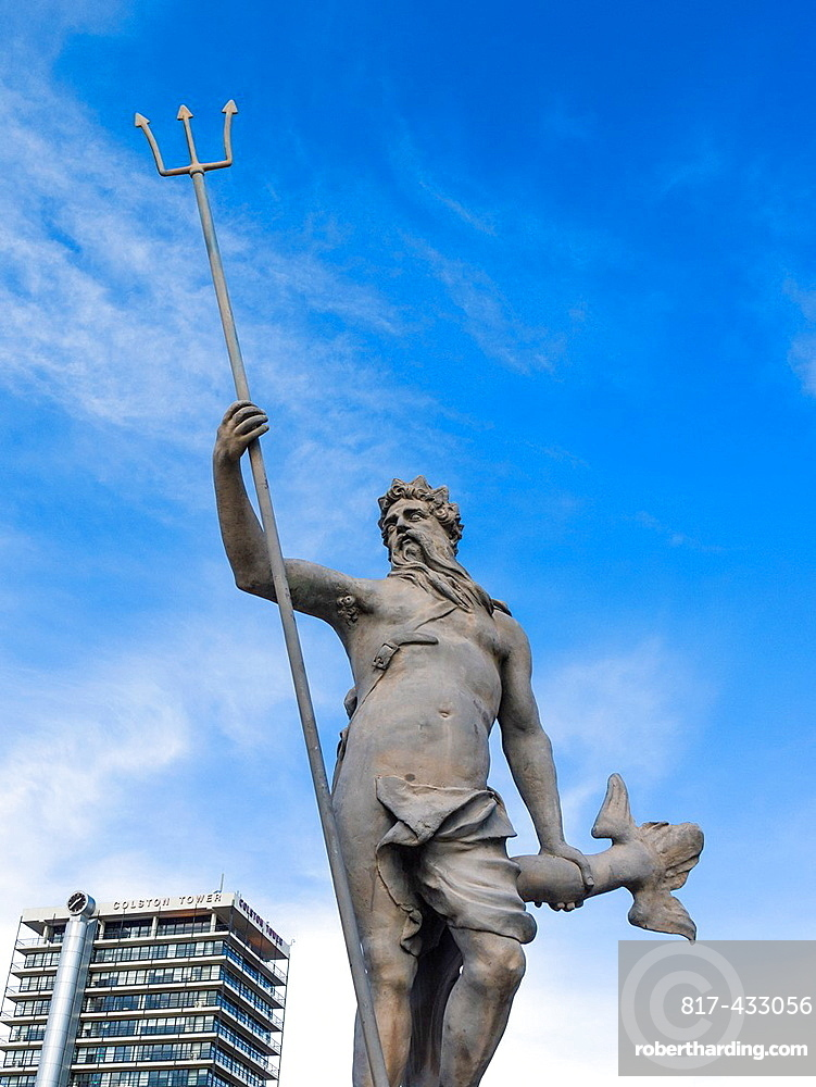 The statue of Neptune in the Bristol City centre with Colston Tower in the background, England