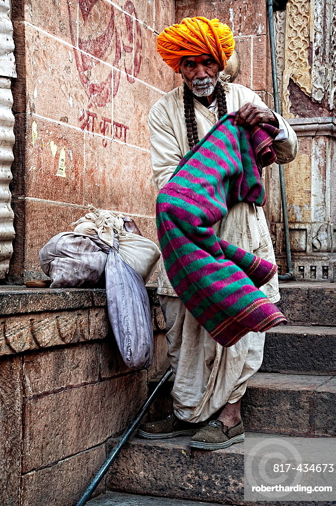 Elder man typically dressed and wearing a big turban outside a temple Jodhpur, Rajasthan, India