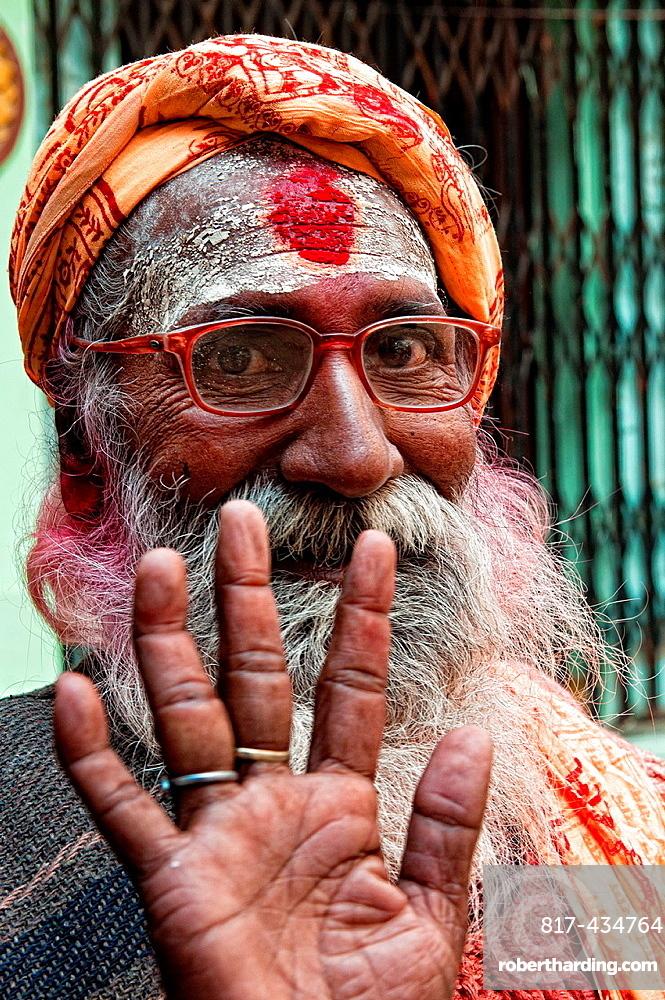 Sadhu saying hello in the streets of Varanasi, Benares, Uttar Pradesh, India