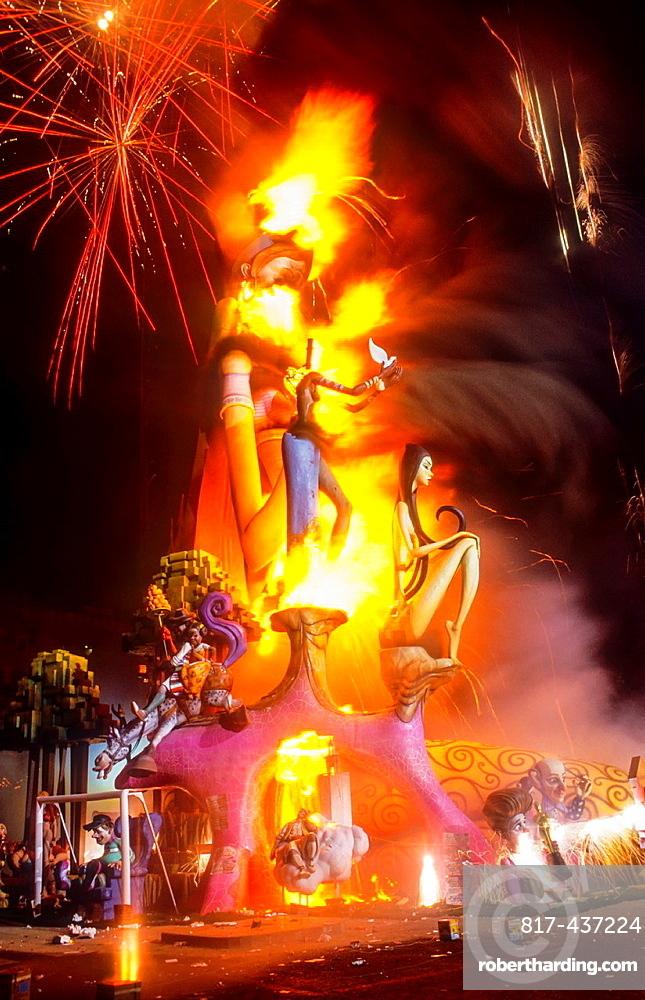 Falla of Plaza del Ayuntamiento burning and fireworks, Fallas festival,Valencia,Spain