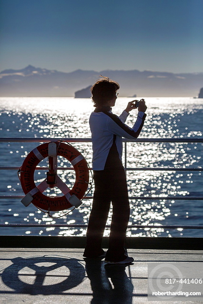 Taking a picture on deck of a cruise ship, Greenland. The Akademik Sergey Vavilov-Russian research vessel built in 1988 currently used as a cruise ship.