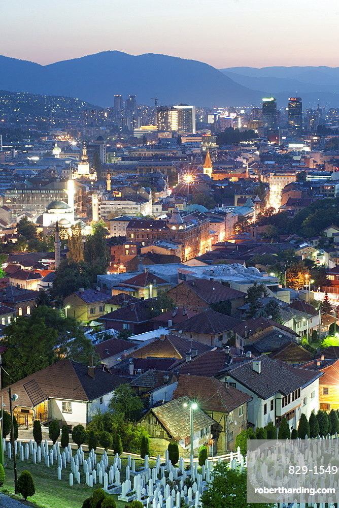 Dusk view of Sarajevo, with the Martyrs Memorial Cemetery, Kovaci, in the foreground, Sarajevo, Bosnia and Herzegovina, Europe