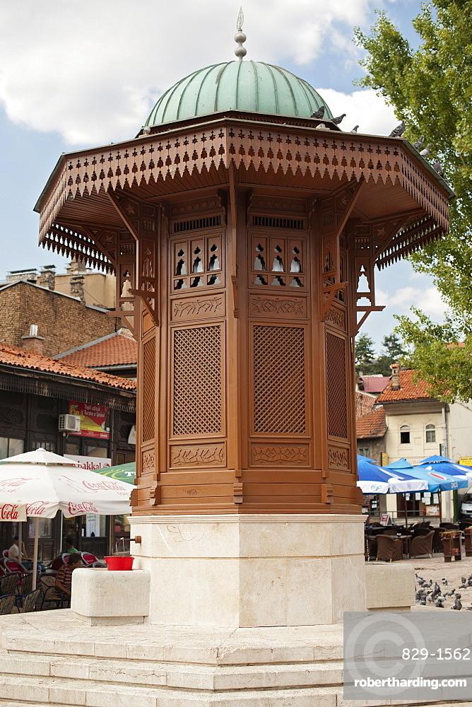 The Sebilj, a wooden and stone fountain in Bascarsija square in Sarajevo, Bosnia and Herzegovina, Europe