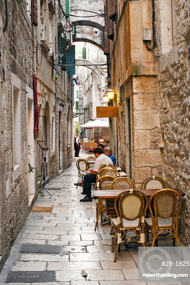 Stone alleyways and restaurants in the old town in the city of Split, Croatia, Europe