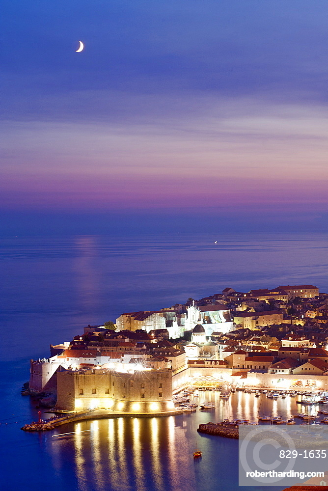 Dusk view of the old harbour port and old town, Dubrovnik, UNESCO  World Heritage Site, Adriatic Coast, Croatia, Europe