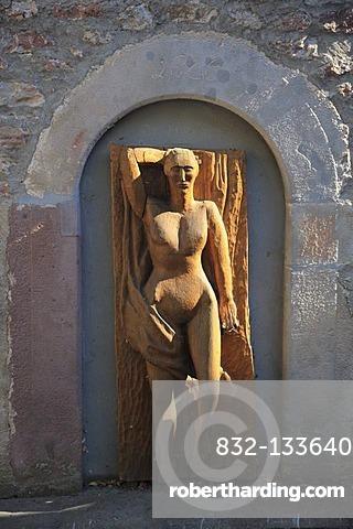 Wood sculpture of a woman's body on the Zehntturm tithe tower in Bischofsheim an der Rhoen, Rhoen-Grabfeld district, Lower Franconia, Bavaria, Germany, Europe