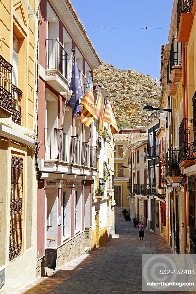 Small alleyway with flags, historic town centre, Busot Aiguees, La Vila Joiosa, Villajoyosa, Costa Blanca, Alicante Spain, Europe