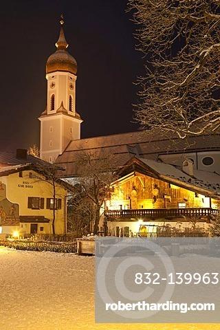 Town view with St. Martin parish church, public library, Mohrenplatz square, snow, blue hour, Garmisch-Partenkirchen, Upper Bavaria, Bavaria, Germany, Europe