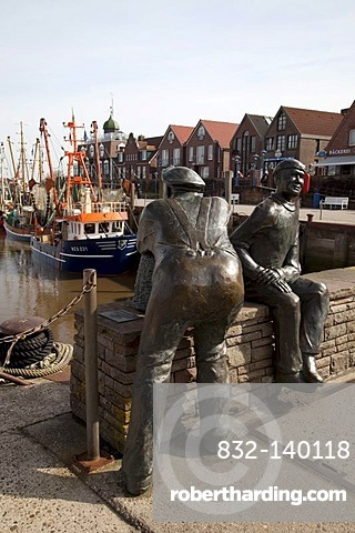 Sculptures, old and young fisherman, harbour, Neuharlingersiel, East Frisia, Lower Saxony, Germany, Europe