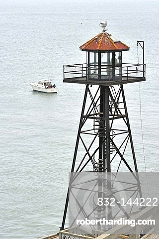 Watchtower and fishing boat at sea, Alcatraz Island, California, USA