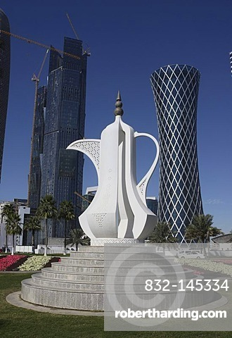 Innovative modern architecture, coffee pot sculpture on a roundabout in front of construction sites in the city, to the right, the 200m and 52 floors high QIPCO Holding Tornado Tower, West Bay District, Doha, Qatar, Middle East