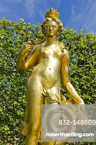 Golden statue of the hunting goddess Diana with boar's head, castle gardens, Schloss Schwetzingen castle, 18th century, Schwetzingen, Baden-Wuerttemberg, Germany, Europe