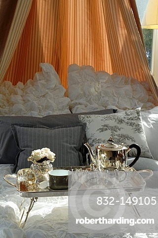 Silver breakfast tray in a canopy bed, Villa & Ambiente, Im Weller 28, Nuremberg, Middle Franconia, Bavaria Germany, Europe