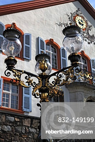 Ancient three-armed lamp in front of the stairway at Buergeln Castle, castle facade at the back, Schliengen, Baden-Wuerttemberg, Germany, Europe