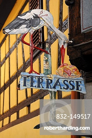 Restaurant sign with a stork on a set table, 44 Rue des Potiers Kaysersberg, Alsace, France, Europe