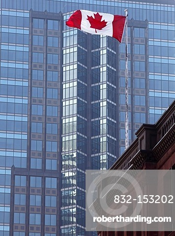 Canadian national flag in front of skyscraper, Montreal, Quebec, Canada