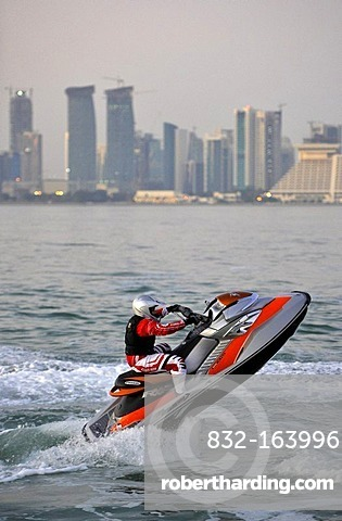 Jet-skiing, jetboat, personal watercraft in front of the skyline of Doha, Qatar, Persian Gulf, Middle East, Asia