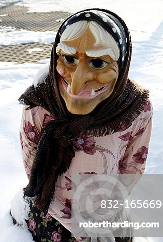 Life-size witch figure in the snow, Thale, Harz, Saxony-Anhalt, Germany, Europe