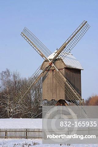 Historic post mill in snow, winter in Hessenpark, Neu-Anspach, Taunus, Hesse, Germany, Europe