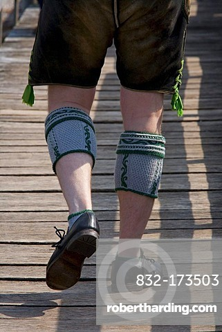 Man with Lederhose leather trousers and calf warmers, Bavarian Haferlschuhe shoes, Bavarian, tradition, traditional costume, legs, Bavaria, Germany, Europe