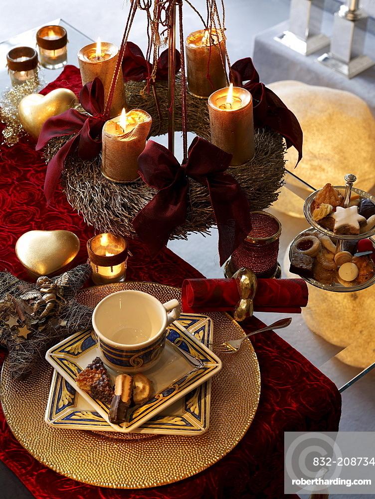 Christmas wreath above a ready laid coffee table