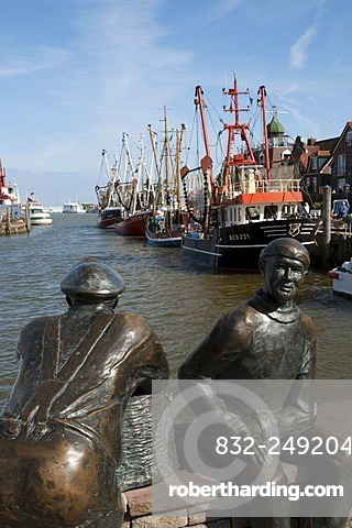 Sculpture old and young fishermen, fishing boats, harbour, Neuharlingersiel, East Frisia, Lower Saxony, Germany, Europe